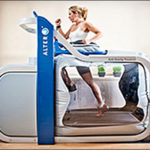 A woman is running on a treadmill.