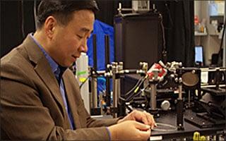 Xingde Li works in his microscope lab.
