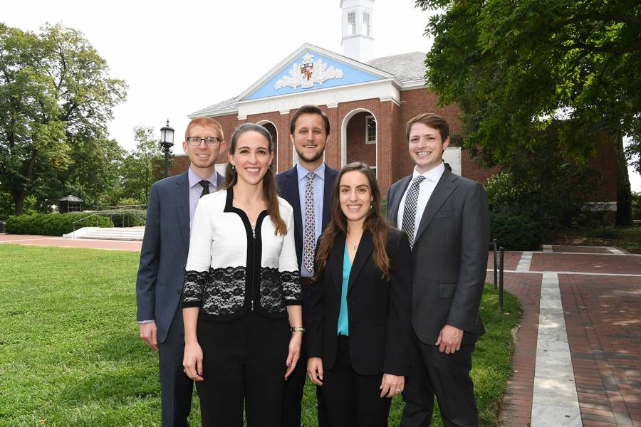 The five Siebel Scholars stand outside and pose for a photo.