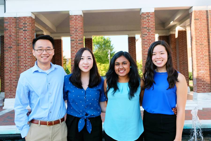 Four students from Team Relavo stand together for a picture.