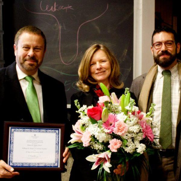Eileen Haase receives an award from the Dean.