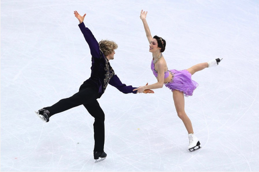 Two figure skaters are skating together on the ice.