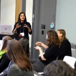 Sri Sarma is speaking to a group of female scientists.