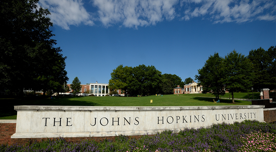 A large Johns Hopkins sign is seen outside.