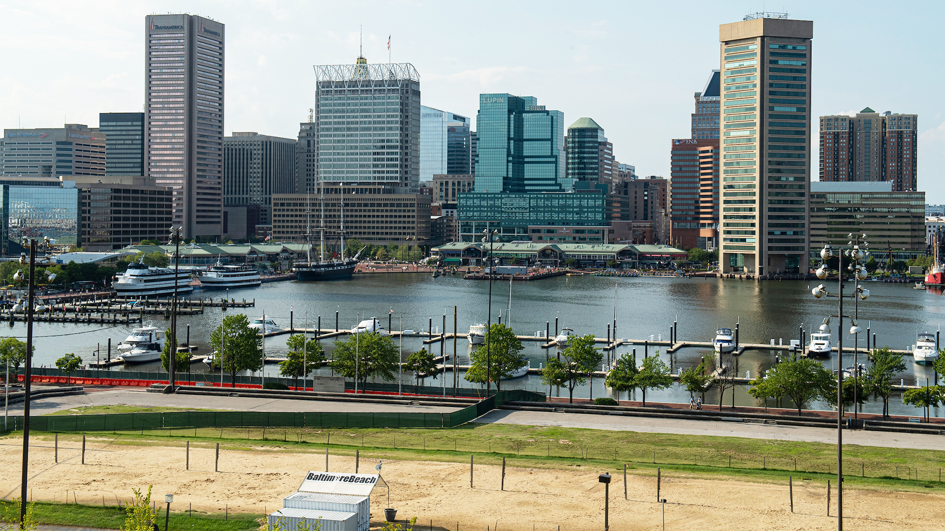 Tall buildings in downtown Baltimore are shown behind the inner harbor.