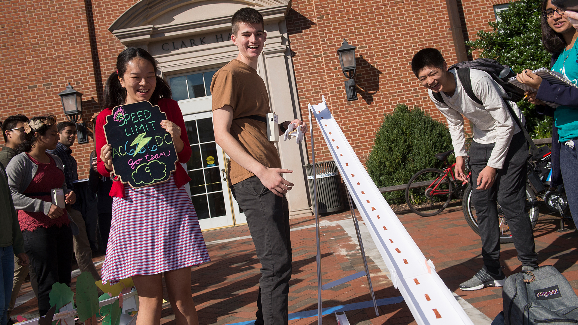 Students are outside of Clark Hall working on their foam core design challenge.