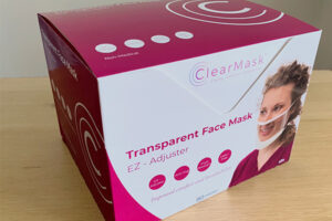 A box of ClearMasks appears on a table.
