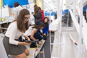 Students work on their foam core projects in the Design Studio.