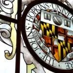The Johns Hopkins University crest is shown.