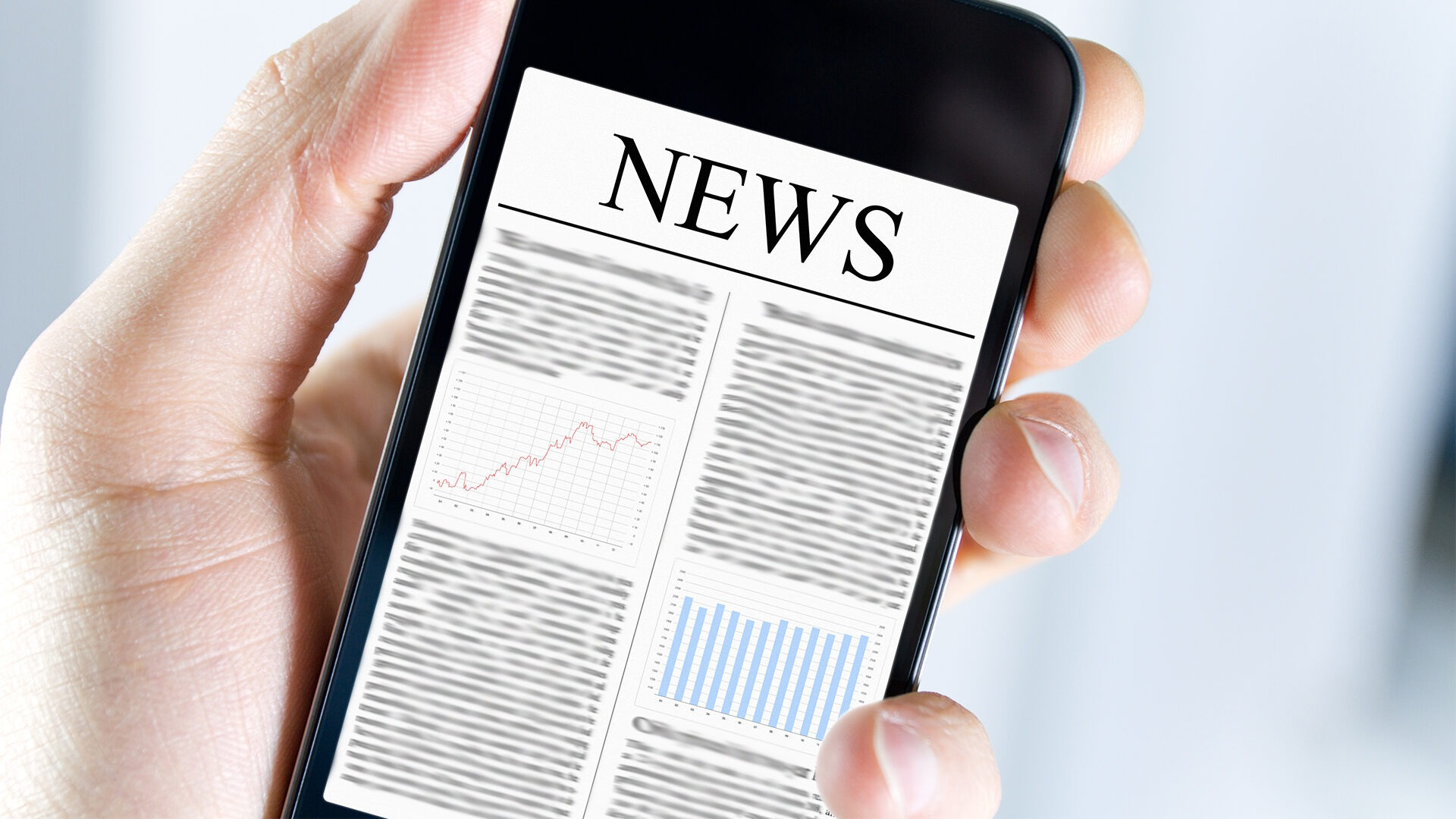 A blurred news webpage is shown on a smart phone.