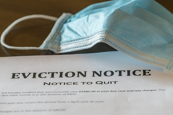An eviction notice is shown next to a surgical mask.